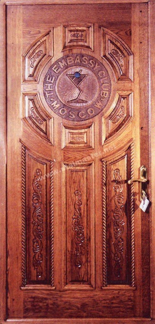 двери металлические с резьбой по дереву